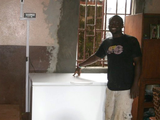 Idrissa with a newly installed vaccine fridge in 2010